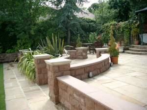 sandstone walls with Haddonstone coping