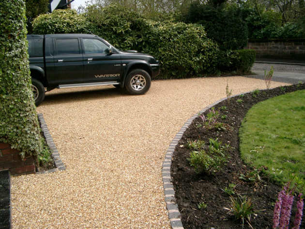 golden gravel with new granite sett edging